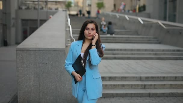 Businesswoman go home after work talking by phone