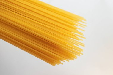 Italian uncooked spaghetti isolated on white background, top vie