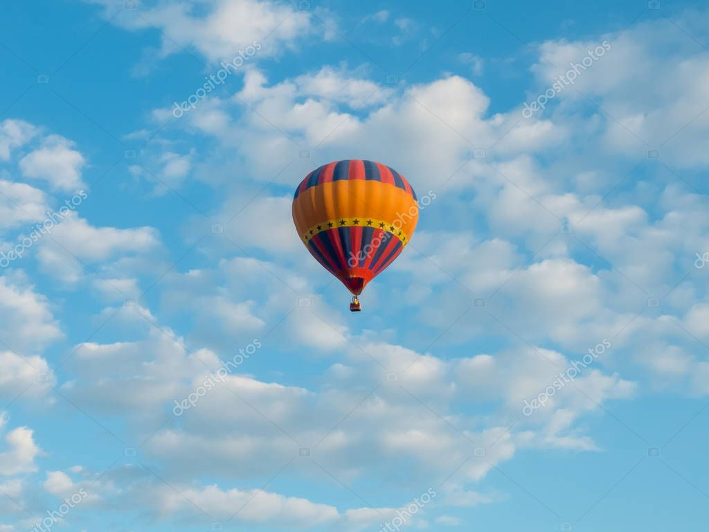 hdr shot of hot air balloons flying in blue sky with white clouds  (selective focus)