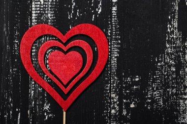 Wooden heart on dark grunge wooden background, valentine day concept stock vector