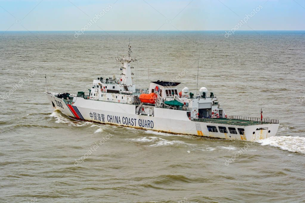 DIAOYU ISLANDS, EAST CHINA SEA - May 19, 2017: Chinese Coast Guard (CCG) 3000T-class offshore patrol vessel No. 2302 patrols in territorial waters off the Diaoyu Islands.