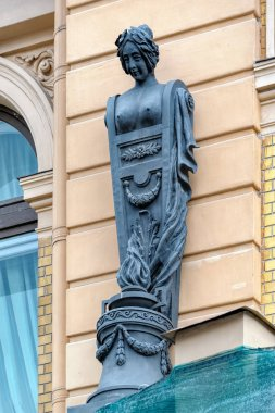 ST.PETERSBURG, RUSSIA -June 19, 2017: Bronze woman sculpture on the facade of Art Nouveau (Jugendstil) style building at Griboedov Canal Embankment.