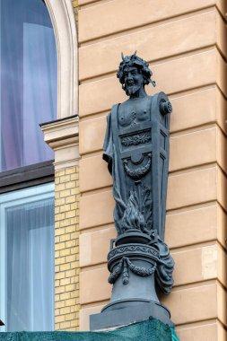 ST.PETERSBURG, RUSSIA -June 19, 2017: Bronze sculpture on the facade of Art Nouveau (Jugendstil) style building at Griboedov Canal Embankment.