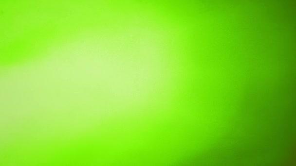 animierte loopable 4k abstrakte bunte Hintergrund mit Grunge-Rauschtextur und hellgrünem Farbverlauf