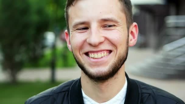 Cheerful young man, laughs at the camera, lifestyle concept, close-up portrait
