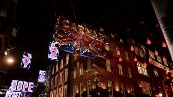 Christmas lights in Carnaby street. United Kingdom flag glitter decoration