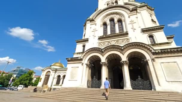 Young caucasian man entering to Alexander Nevsky cathedral in Sofia, Bulgaria