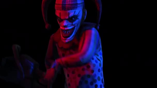 Creepy seamless animation of an horror clown with a chainsaw. Halloween background of a terror character isolated with alpha channel