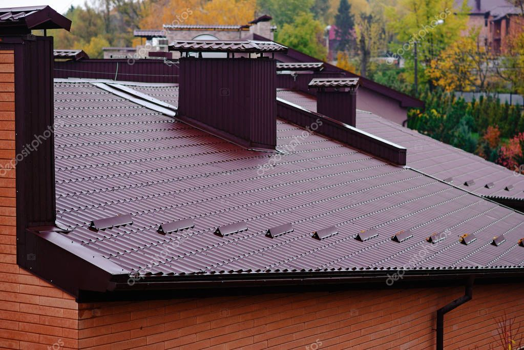 roof with chimneys with modern driver, autumn