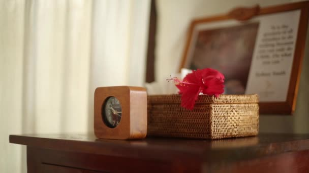 Spa accessories and decor: moisturizer, oils, candles, towels, flowers at tropical island spa therapy center on Maldives