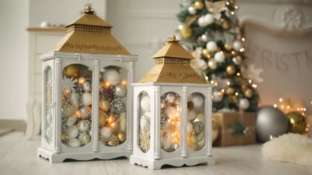 Stylish White Christmas Interior With Decorated Lanterns Fireplace Lanterns Lamps Candles Bumps Comfort Home With Christmas Tree Full Of Golden Decorations Lights And Garlands New Years Eve Stock Video C Artiemedvedev 221118240