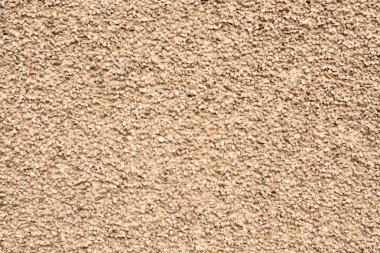 stone background light-brown color with a grainy texture