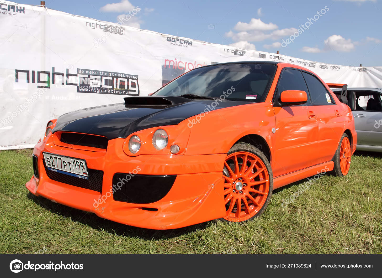 Moscow, Russia - May 25, 2019: A bright orange Subaru WRX