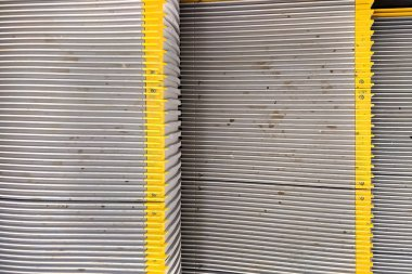 Texture, Dirty Escalator steps with yellow stripes. A set of old-fashioned metal escalator steps