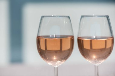 Two glasses of rose wine on a wooden table