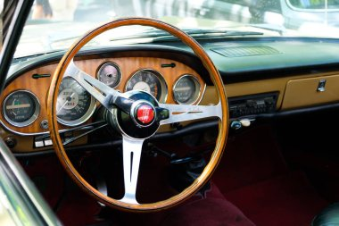 Berlin, Germany - june 09, 2018: Steering wheel, dashboard and interior of beautiful vintage car cockpit at Classic Days, a Oldtimer  event for vintage cars and  vehicles in Berlin