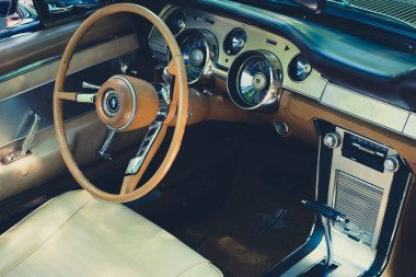 Berlin, Germany - june 09, 2018: Steering wheel, dashboard and interior of Ford Mustang vintage car cockpit at  Oldtimer  event for vintage cars and  vehicles in Berlin