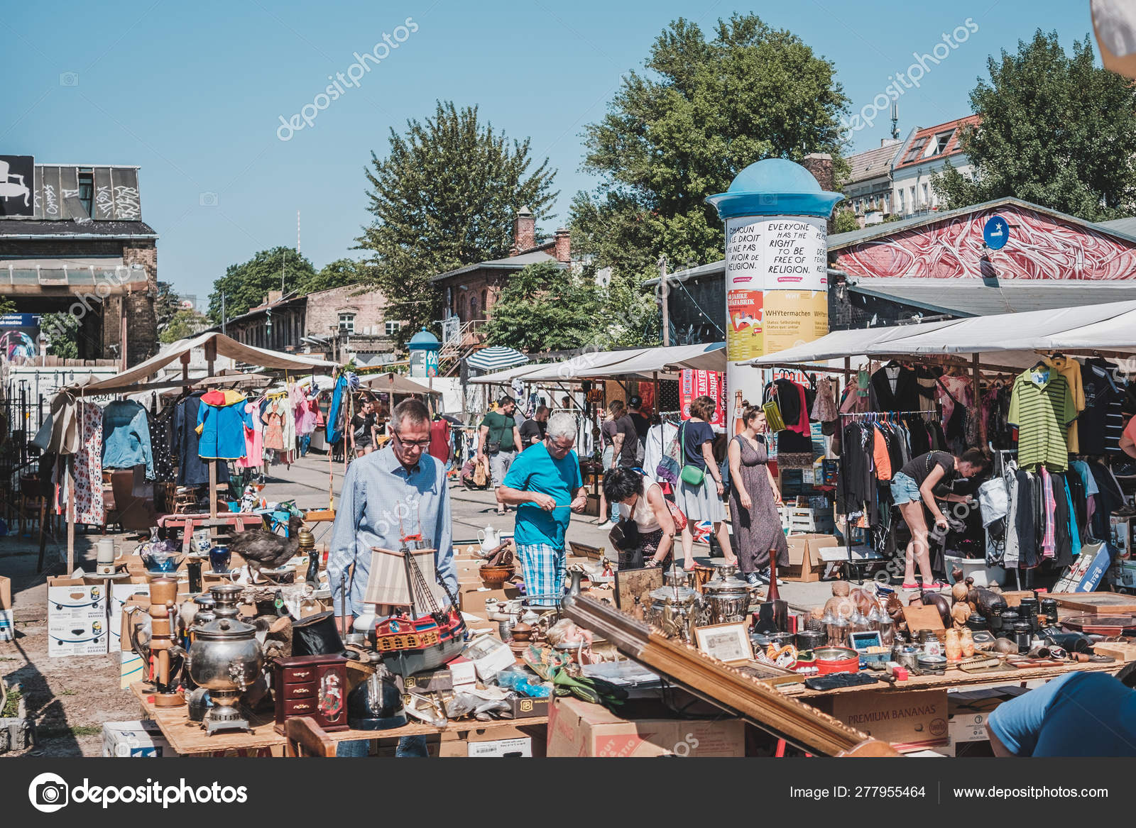People on Raw flea market on a sunny sunday in Berlin