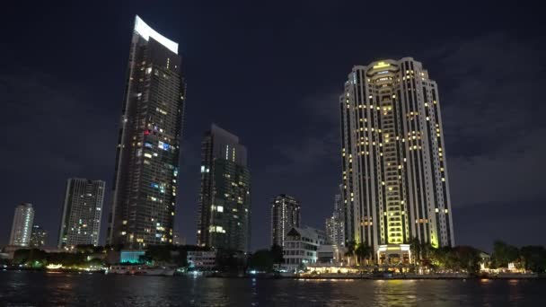 night city view with office buildings on the river bank. metropolitan business district