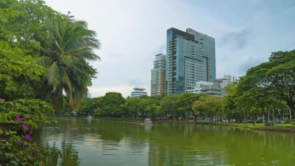 Corporate buildings with offices overlooking a green park with a lake. business center of a large city, business district.