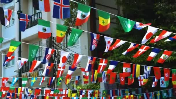 flags of different countries hang on city streets