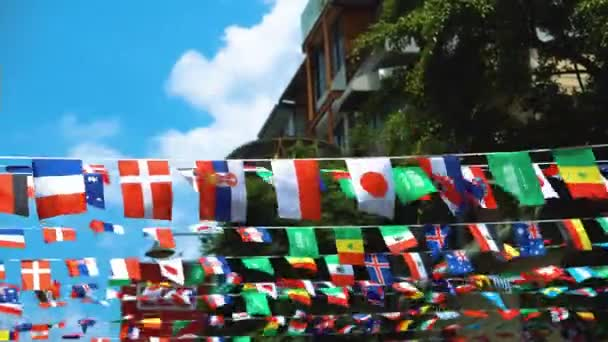 flags of states all over the world are fluttering in the wind