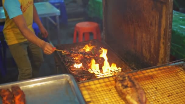 Chef cook chicken saute on grill at food market