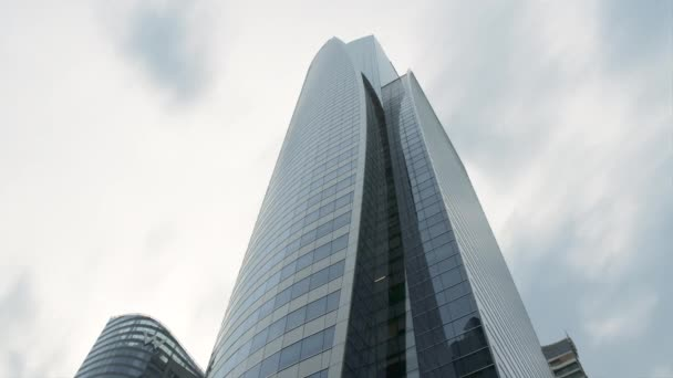 Bottom view of the tall building made of steel and glass, modern architecture