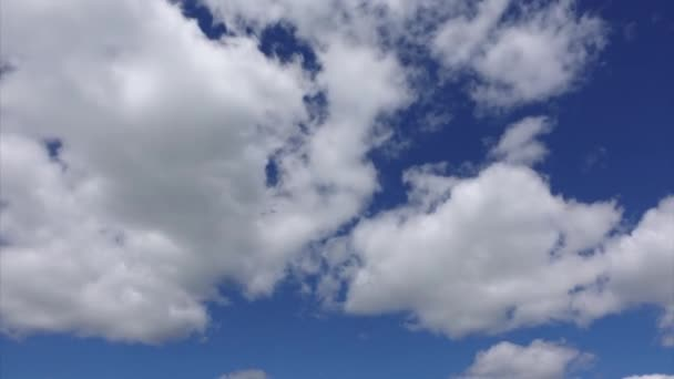 Timelapse shot of clouds. White clouds high in the blue sky, nature colors