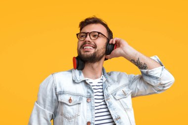 Happy bearded man listening to music