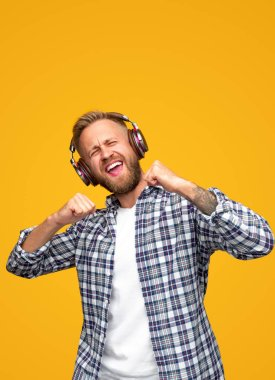 Excited man listening to music and dancing