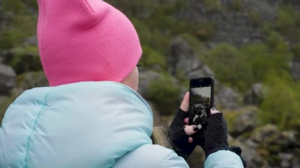 Girl taking pictures of nature