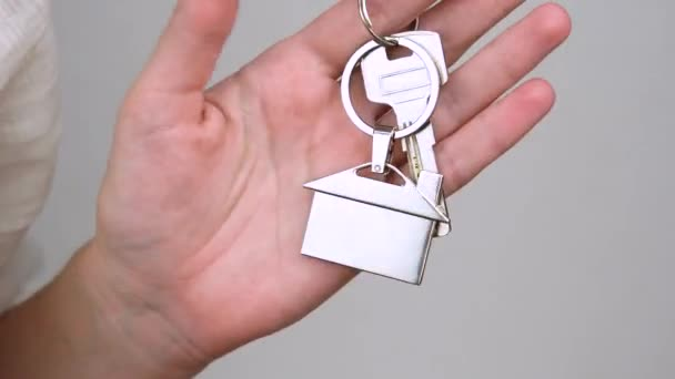 woman hand holds key chain house keys closeup real estate sale