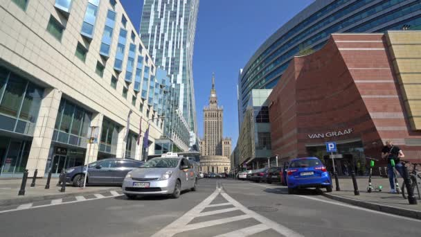 Warsaw, Poland. April 2019.  The traffic in the city with the  Palace of Culture and Science on the background.