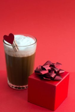 coffee and red gift box on red background