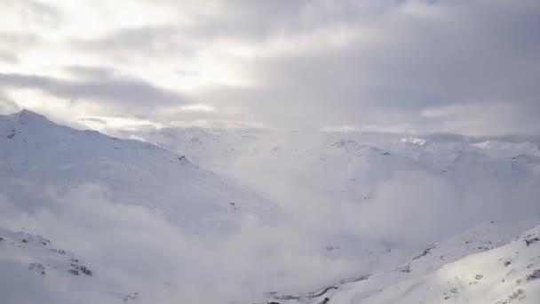 Amazing winter landscape of mountains surrounding small modern ski resort.