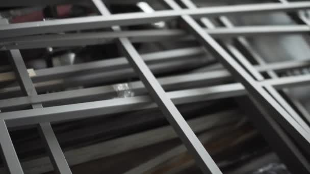 Bunch of grey metallic frames are placed on floor in room.