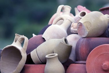 Set of stacked together broken clay pots