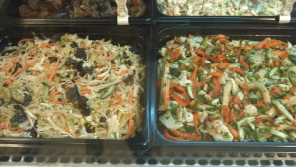 Set of various salads.Salads in the supermarket: Greek salad, seafood salad, Chinese salad, salad from greens and vegetables.