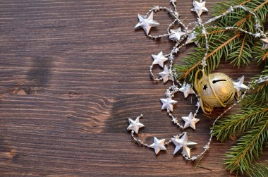 Christmas wooden background with fir tree and shiny decorations