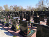 Rows of cemetery monuments in black at the cemetery.