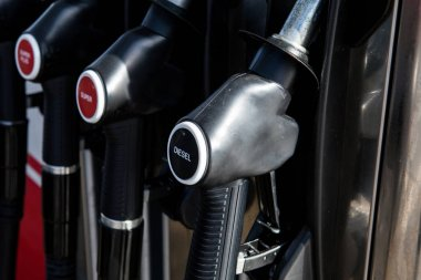 Diesel fuel pumps at petrol station with german text