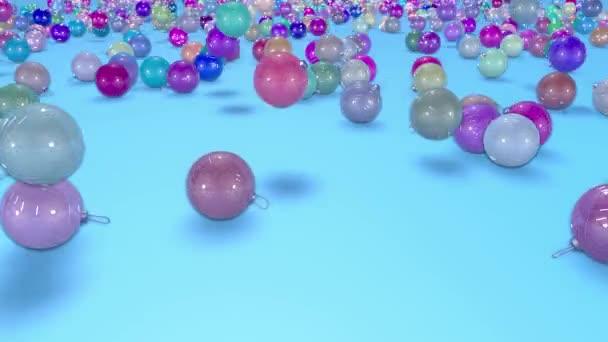 Vánoční koule rozpadat na podzim k povrchu s hloubkou ostrosti. 3D animace pro nový rok složení nebo pozadí.