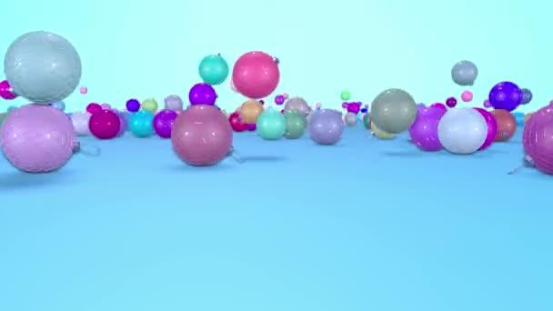 Vánoční koule rozpadat na podzim k povrchu s hloubkou ostrosti. 3D animace pro nový rok složení nebo pozadí. vícebarevná