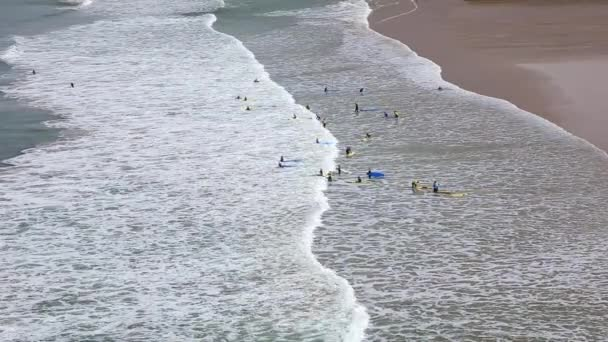 Surfers in the waves off Mawgan Porth Beach