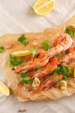 Grilled shrimps with spice, garlic and lemon. Grilled seafood. top view