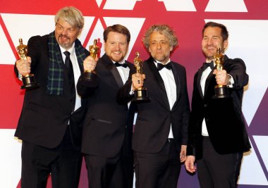 Ian Hunter, J.D. Schwalm, Paul Lambert and Tristan Myles at the 91st Annual Academy Awards - Press Room held at the Loews Hotel in Hollywood, USA on February 24, 2019.