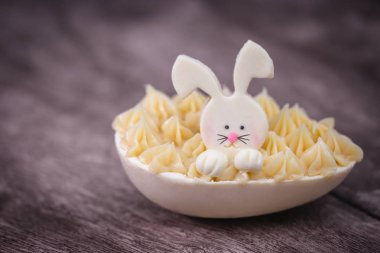 Easter egg with chocolate bunny, fun egg with decorative easter bunny.