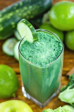 Fresh green juice, Brazilian detox juice. drink that has components that favor liver cleansing, Green smoothie with ingredients on wood table, healthy food concept. Diet or regimen concept.
