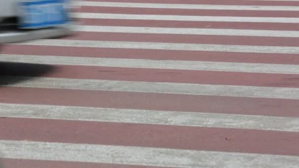 People walking on the crosswalk Yiwu in Summer.Its a slow motion video that people took on crosswalk in Yiwu, China.